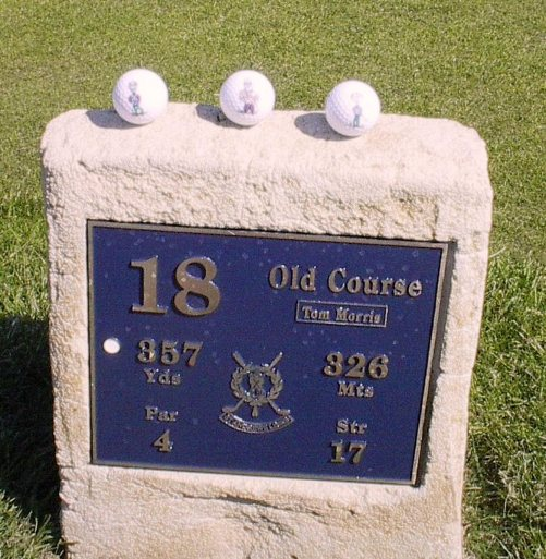 the Pals at the 18th hole marker